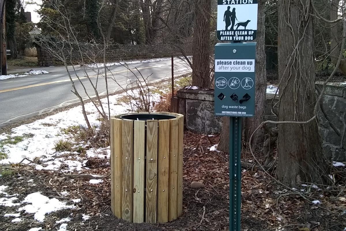 Trash receptacle and dog waste station