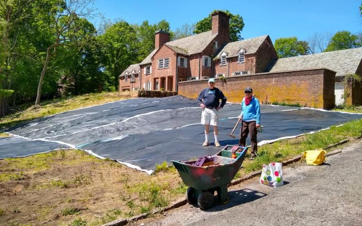 Tarps being laid by John Colgan and Alison Crowther